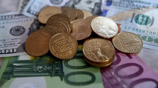 Доллар вырос до57,09 рубля