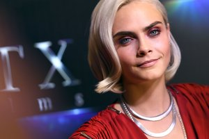 Model Cara Delevingne surprised neckline to the navel