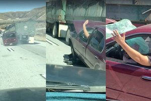 Видеошок: водитель грузовика несколько километров тащил легковушку и ничего не заметил