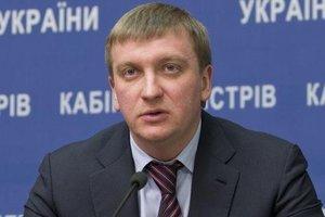 Министр Петренко подает в суд на Саакашвили