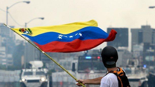 Из-за кризиса у Венесуэлы возникли проблемы с выплатами по кредитам. Фото: AFP