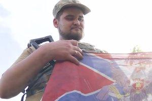 Украинские военные подвели итоги боя под Желобком и показали трофейный флаг боевиков