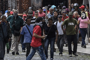 In Venezuela, the evacuation of people from the Parliament building