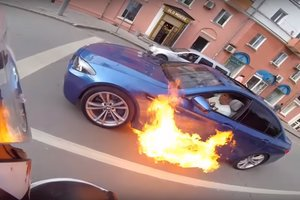 The driver accelerated, trying to extinguish a burning BMW