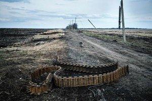 В результате обстрелов на Донбассе ранен украинский боец