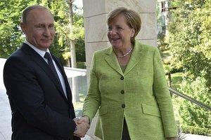 Путин поздравил Меркель с победой на выборах в Германии