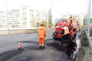 In Kiev, the utility outlined hearts patched holes in the asphalt