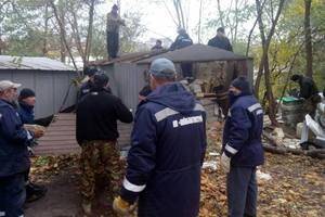 В Киеве массово сносят незаконные гаражи