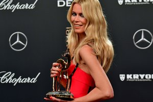 Claudia Schiffer in a Versace dress won unfading beauty