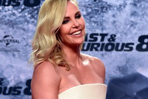 Charlize Theron showed a figure in a swimsuit on the beach in Mexico