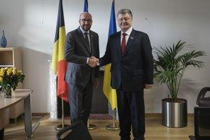 Порошенко обсудил с премьерами Финляндии и Бельгии миротворцев и санкции против РФ