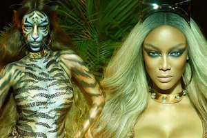 Golden thongs, claws and handcuffs: tyra banks starred for the fashion glossy in a suit tigress