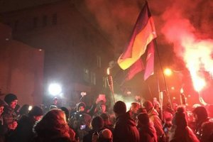 Torchlight procession in Kiev law enforcement officers were pelted with fireworks under the building AP
