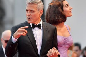 George and Amal Clooney will play a wedding