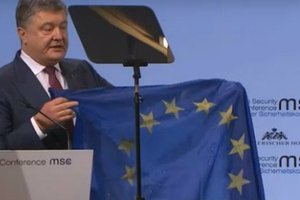 Poroshenko showed in Munich riddled the EU flag, brought from the Donbass