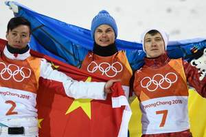Olympic athletes from Russia posed on the background of Ukrainian flag