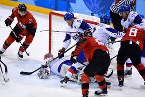 Canadian hockey players defeated the hosts of the Olympics and reached the quarter-finals