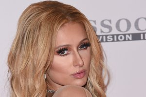 Paris Hilton has appeared in a short dress with a naked effect