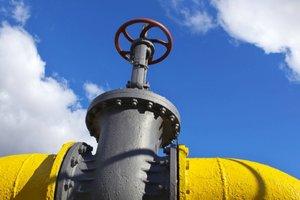 """Проблемы с транзитом газа через Украину могут ударить по рейтингу """"Газпрома"""" - S&P"""