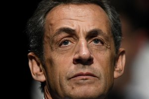 Sarkozy charged with