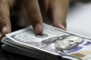 Курс доллара приближается к психологической отметке
