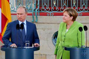 Ангела Меркель и Владимир Путин. Все фото: AFP
