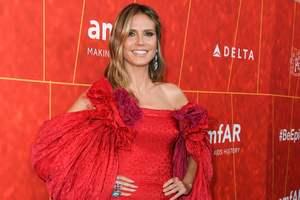 В роскошном красном платье от Zac Posen: новый выход Хайди Клум