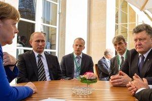 """Порошенко и Путин не зря приглашены в Париж: эксперт рассказал о """"хитром плане"""" Меркель"""