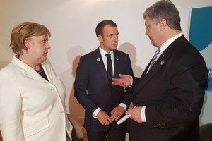 Донбасс, миротворцы, война: что нужно знать о визите Порошенко во Францию