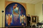 Луганский художник рисует огромный лик Христа, который светится в темноте