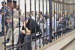Обвиненным в пособничестве Каддафи украинцам сменили тюрьму в Ливии