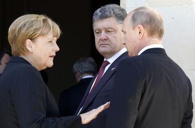 Путин и Порошенко пожали друг другу руки - французские дипломаты