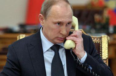 В Кремле рассказали, о чем Путин говорил с Порошенко, Меркель и Олландом