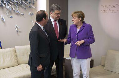 Завтра Порошенко, Олланд и Меркель обсудят ситуацию в Украине