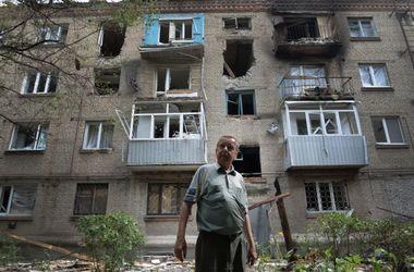 В городе Попасная боевики выгоняют местных жителей из квартир