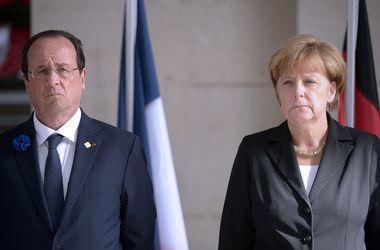Меркель и Олланд призвали Порошенко объявить перемирие