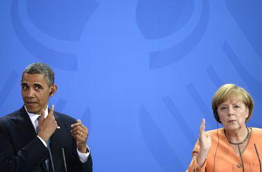 Обама и Меркель созвонились и пригрозили России новыми санкциями