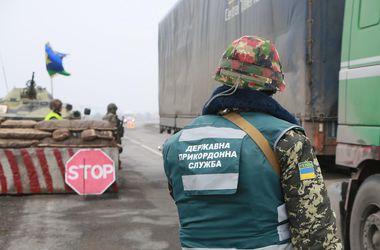На Одесской границе поймали нелегалов, которые прятались между колесами грузовика