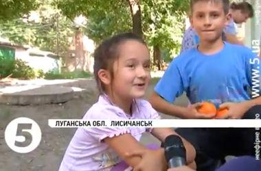 """""""Мы сидели в бомбоубежище, а они стреляли под нашими окнами"""": жители Лисичанска об """"ополченцах"""""""