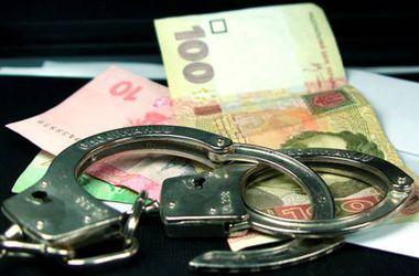 Под Киевом судят чиновника, требовавшего взятку в полтора миллиона гривен