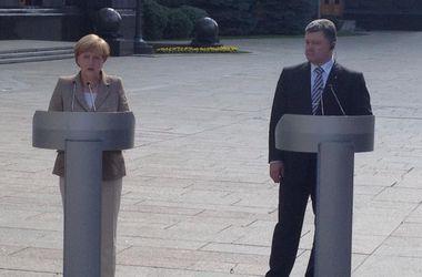 Порошенко и Меркель обсудили привлечение 500 млн евро помощи ЕС на восстановление Донбасса