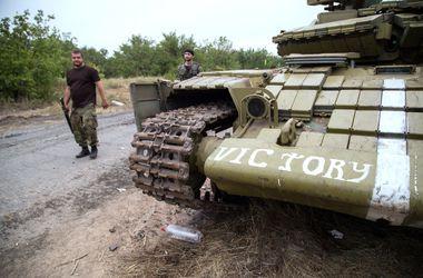 В зоне АТО за сутки погибли 12 военнослужащих, 19 ранены – СНБО