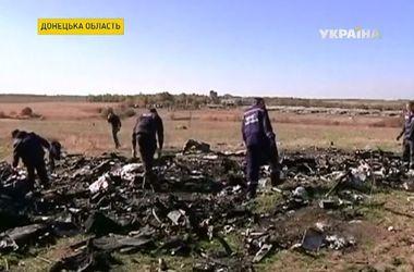 """Голландские эксперты на месте крушения """"Боинга"""" нашли паспорта жертв авиакатастрофы"""
