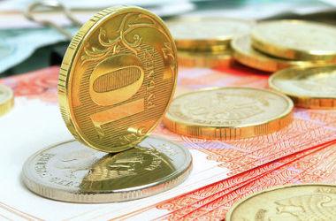 Российский рубль третий день подряд  рекордно дешевеет