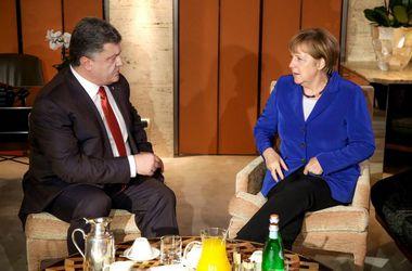 64_main В Милане началась встреча Порошенко и Меркель