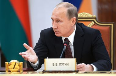 Путин опоздал на встречу с Меркель