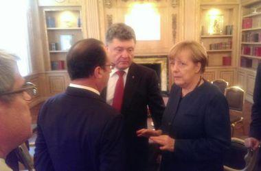 Порошенко, Меркель и Олланд продолжили переговоры без Путина