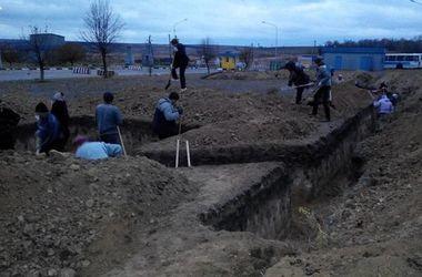 Харьковчане обустраивают блиндажи под гимн Украины