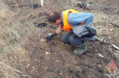 В сожженной колонне под Иловайском нашли останки женщины-военной и кости