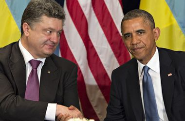 Обама обещает Украине помочь вернуть Крым